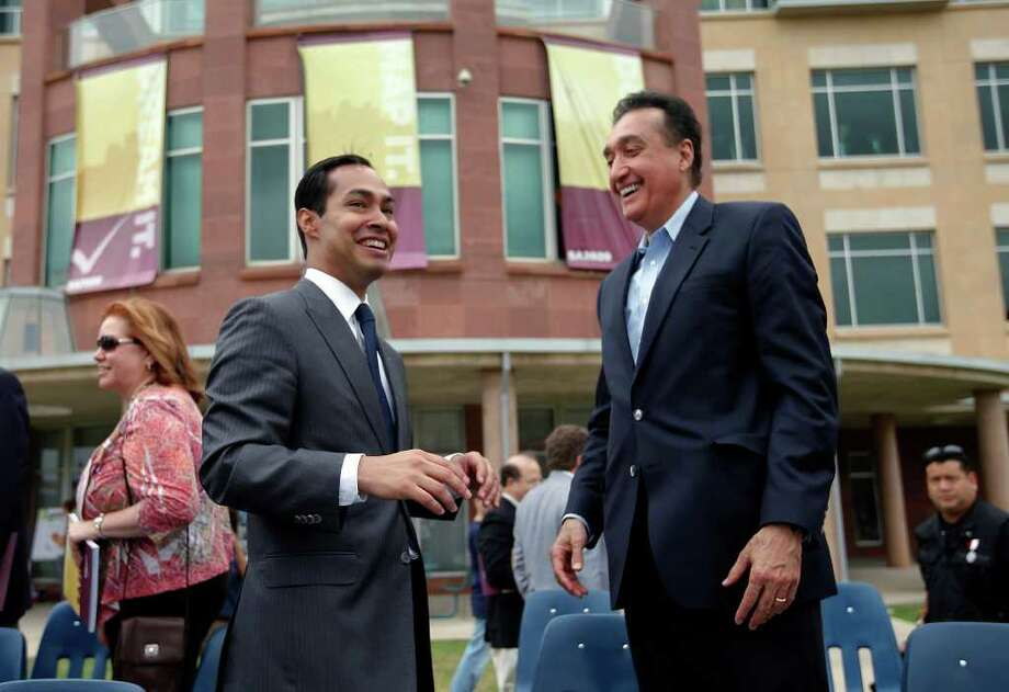 Mayor Julian Castro (left) shares a celebratory moment with former mayer Henry Cisneros after announcing the first series of projects to come from SA2020 at the UTSA downtown campus on Saturday, Mar. 19, 2011. Castro credited Cisneros' efforts for the Target '90 project which its mission was similar to the current SA2020 campaign. Kin Man Hui/kmhui@express-news.net Photo: KIN MAN HUI, Kin Man Hui/kmhui@express-news.net / San Antonio Express-News