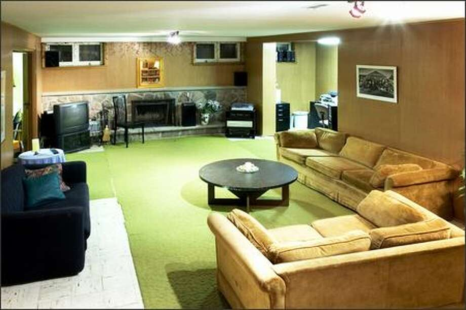 The dated wood paneling and dingy green carpet gave away the rec room's origins. Photo: / HGTV