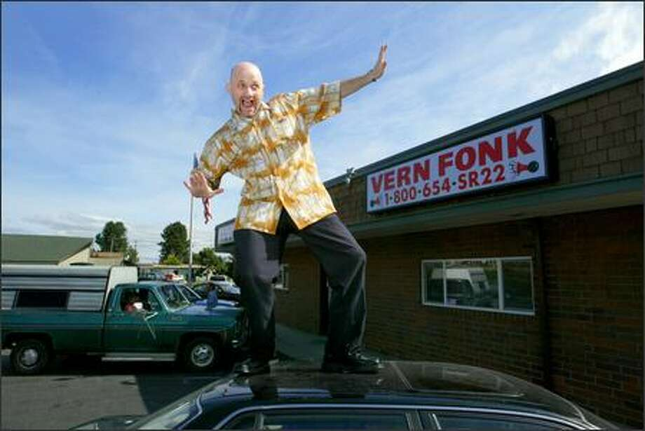 Rob Thielke, who some people believe actually is Vern Fonk, does his wild and crazy thing outside his Everett office for the benefit of a photographer. Photo: Scott Eklund/Seattle Post-Intelligencer