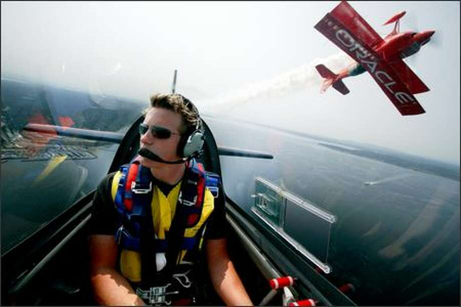 Actor David Ellison takes his plane for a spin over Puget Sound last Thursday along with an Oracle Challenger piloted by Sean Tucker. Photo: Joshua Trujillo/Seattle Post-Intelligencer