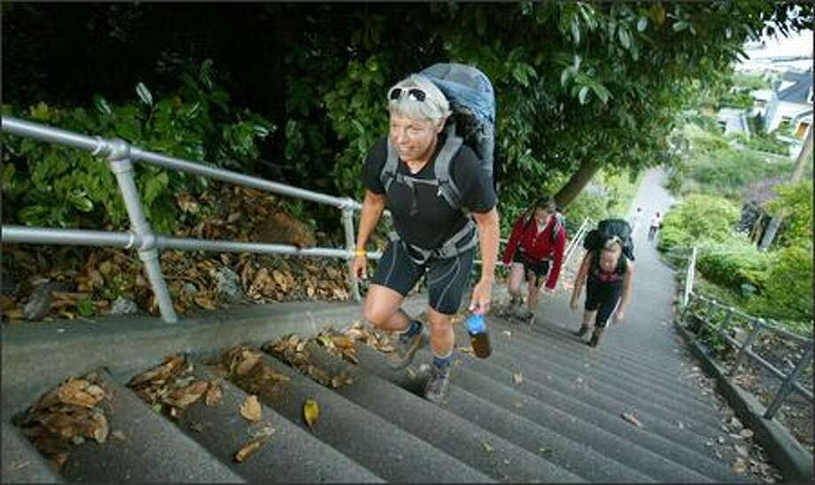 Eve Ruff trains on Capitol Hill's Lakeview stairs with Meghan Galvin, left, and Corey Kelman in preparation to lead a group of women up Mount Rainier later this month. Ruff, a drug and alcohol counselor, has climbed Rainier before, but never sober. Photo: Paul Joseph Brown/Seattle Post-Intelligencer