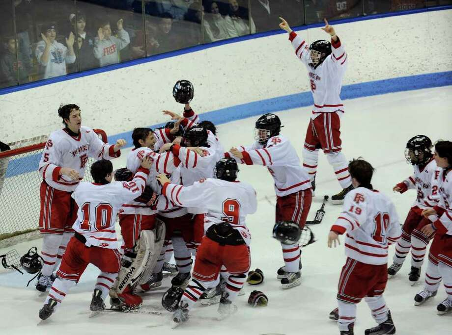 Fairfield Prep celebrates its win over St. Joseph, during the state final of CIAC boys hockey at Yale's Ingalis Rink in New Haven, Conn. on March 19, 2011. Photo: Christian Abraham / Connecticut Post