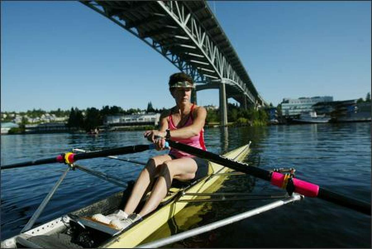 Stephanie Duncan, 54, takes off from the dock of the Pocock Rowing Center in Seattle for a morning workout in her single scull. She has more than two dozen national gold medals -- and five world golds.