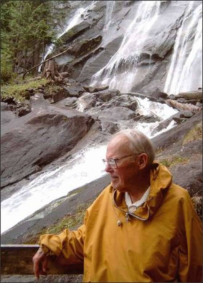 Longtime hiker and guidebook auther Bob Dreisbach pauses at an overlook of Bridal Veil Falls, a side trip on the trail to Lake Serene. Photo: KAREN SYKES