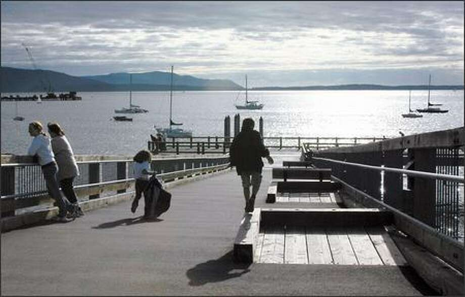 Bellingham's new Taylor Street Dock in Fairhaven leads visitors down to an over-water boardwalk that has become the delight of locals and visitors alike. The new facility links the Fairhaven neighborhood to the edges of Bellingham's downtown. Photo: GORDY HOLT/P-I