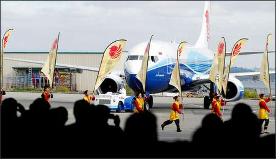 Indonesian dancers accompany the rollout Tuesday of the first 737-900ER at Boeing's Renton plant. Lion Air is among the first customers. Photo: Paul Joseph Brown/Seattle Post-Intelligencer