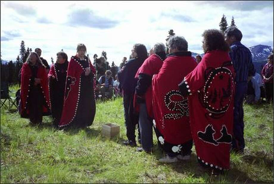 "Tribal chiefs and elders from northern British Columbia convene in a historic hunting area at the headwaters of several major river systems in Iskut, B.C., last weekend. Marie Louie of the Iskut Band, third from left, leads a ceremony that symbolized their determination to keep the land ""wild, beautiful and sacred forever."" Photo: Joel Connelly/Seattle Post-Intelligencer"