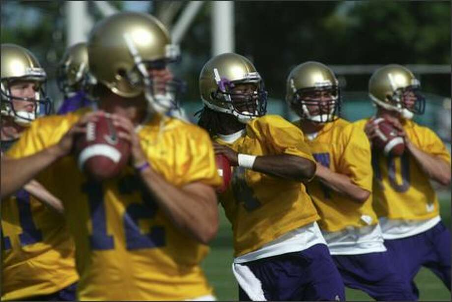 The University of Washington football team opened its fall drills with five quarterbacks, from left, Carl Bonnell (11), Johnny DuRocher (12), Isaiah Stanback (4), Felix Sweetman (17) and Jake Locker (10). Photo: Grant M. Haller/Seattle Post-Intelligencer