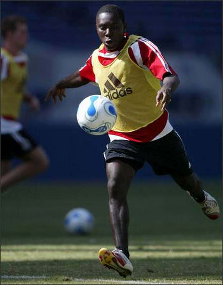 Freddy Adu of D.C. United practices at Qwest Field for tonight's exhibition. Photo: Joshua Trujillo/Seattle Post-Intelligencer