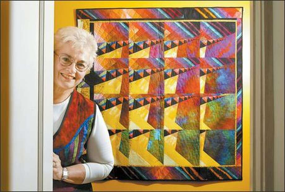 """Quiltmaker extraordinaire Lorraine Torrence incorporated a technique that she created -- she calls it """"shifting perspectives"""" -- into """"Thunderclouds Approaching,"""" one of her pieces from 2005. Torrence has been quilting since 1971, when she made a quilt as a wedding gift. . Photo: DAN DELONG/P-I"""