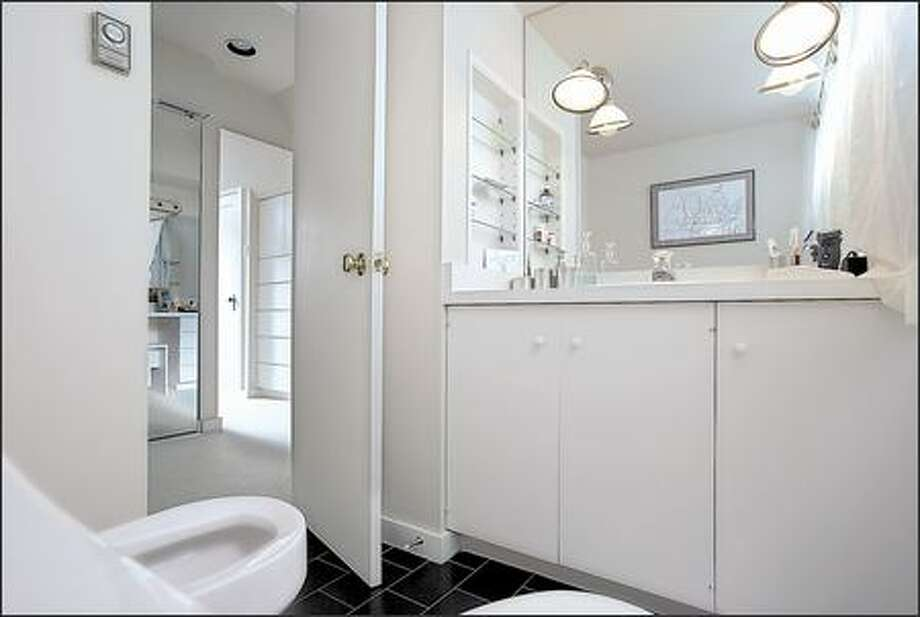 The master bedroom's small, dingy en suite bathroom was cramped and outdated. Photo: / HGTV