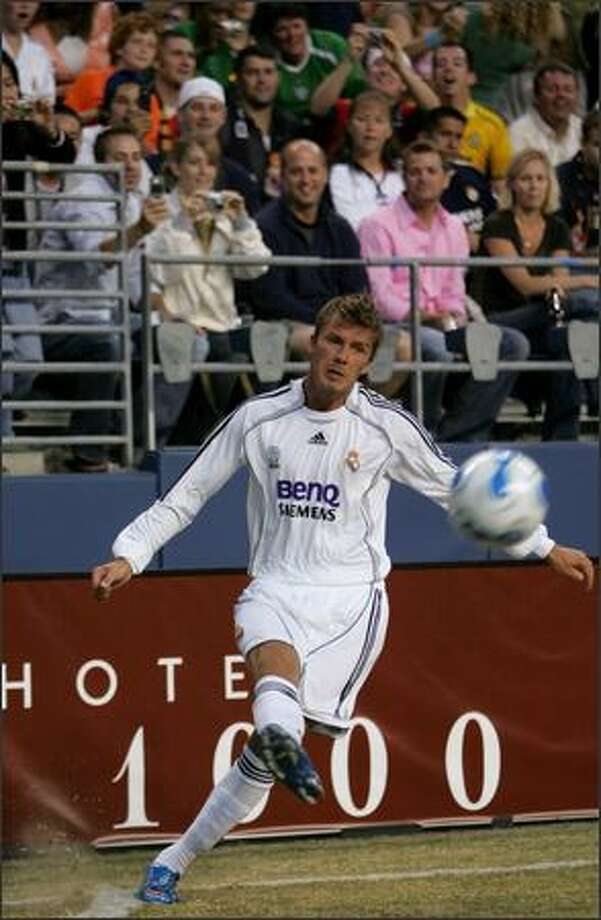"Real Madrid's David Beckham kicks the ball into play during the first half. Beckham didn't play in the second half, and when asked later about playing for a U.S. team in the future, he said, ""It's a great country; maybe someday I will."" Photo: Joshua Trujillo/Seattle Post-Intelligencer"
