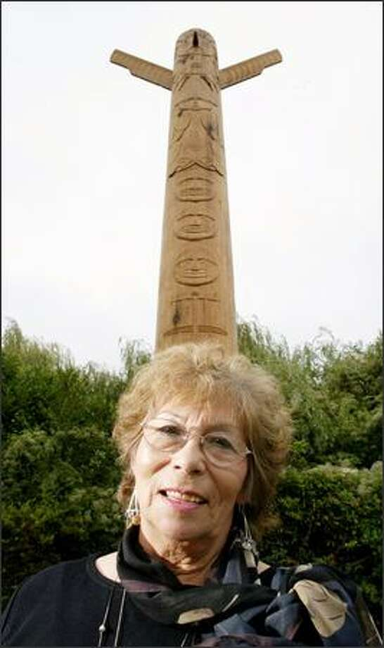 Duwamish Tribal Chairwoman Cecile Hansen poses in front of the new totem pole erected at the Admiral Way Viewpoint, 3600 Admiral Way S.W., in West Seattle. Photo: Dan DeLong/Seattle Post-Intelligencer
