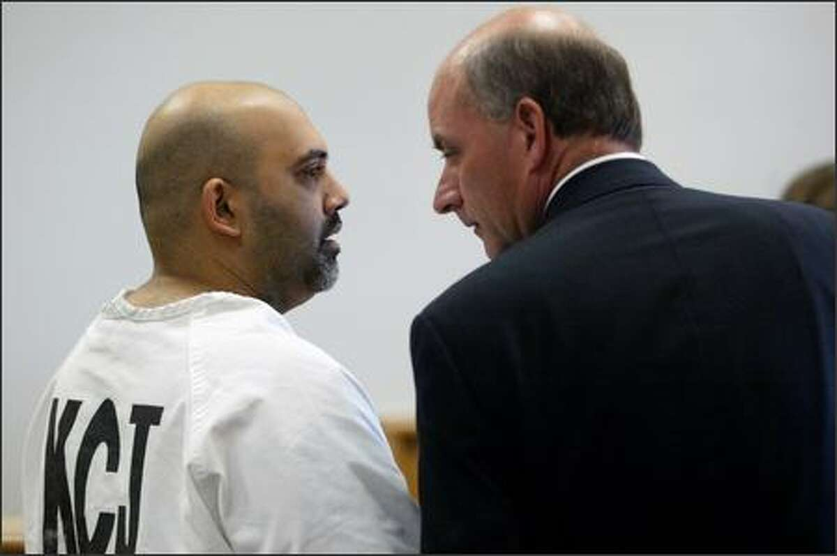 Naveed Haq, with his attorney, C. Wesley Richards, during proceedings at the King County Courthouse in Seattle on Thursday.