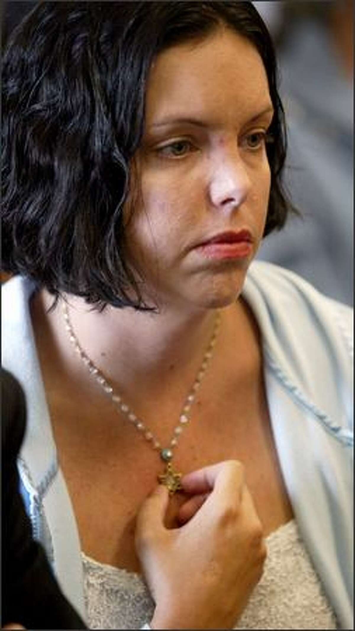 Jewish Federation employee Tammy Kaiser, who escaped the shooting by jumping out a window, listens in court.