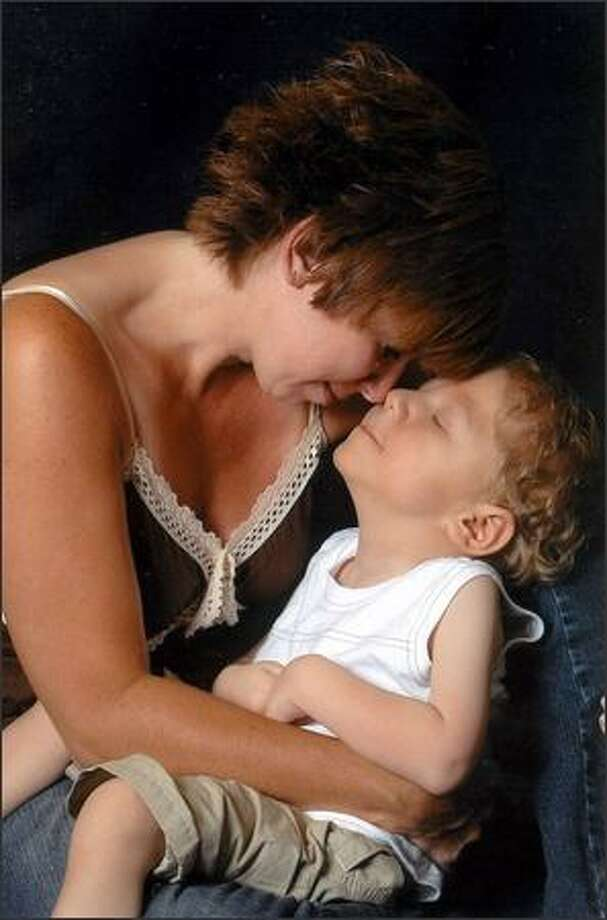 Jami Coonts holds her son, Jameson, who died July 29 just before he was to turn 5. He was legally blind and hearing impaired. Photo: / Acclaimed Photography