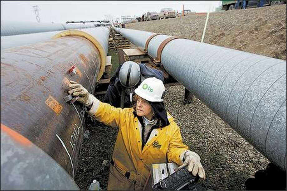 Charlotte Foley works on the oil spill cleanup at BP's Prudhoe Bay oil fields in Alaska. The company will keep pumping crude from the western half of the largest U.S. oil field. Photo: / Bloomberg News