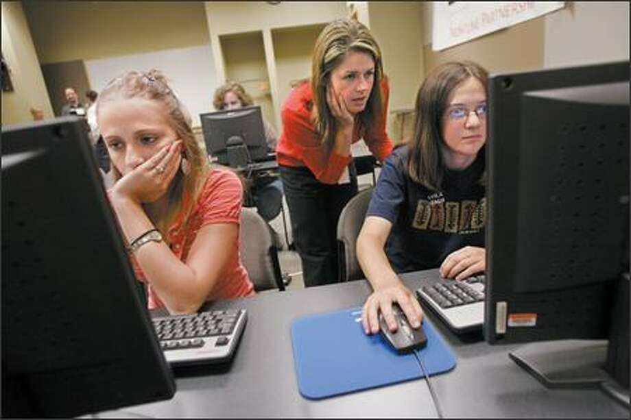 "Microsoft product manager Marissa Rocha advises Rachel Fenichel, 14, of Bellevue during Tuesday's ""DigiGirlz"" day camp. To the left is Sari Radecke, 15, of Sammamish. Photo: Mike Kane/P-I"