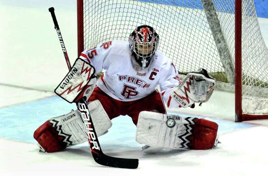 Fairfield Prep goalie John Galiani prepares to stop a St. Joseph goal attempt, during the state final of CIAC boys hockey at Yale's Ingalis Rink in New Haven, Conn. on March 19, 2011. Photo: Christian Abraham / Connecticut Post