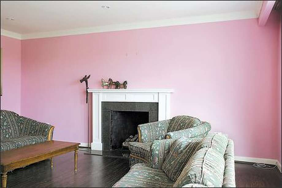 Walls in a cloying shade of bubblegum pink marred the best room in the house. Photo: / HGTV