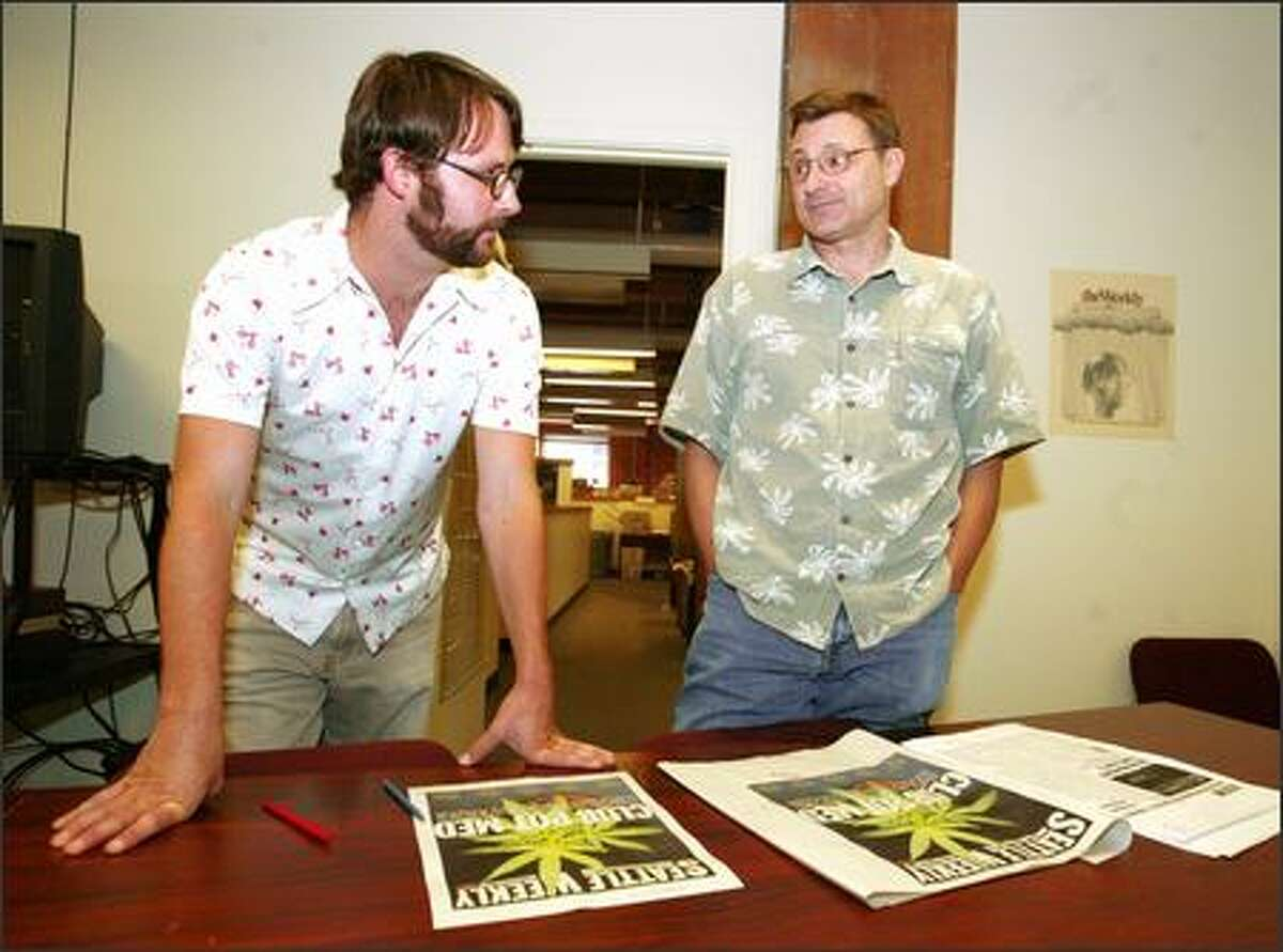 Mike Seely, left, who once served as managing editor of Seattle Weekly.