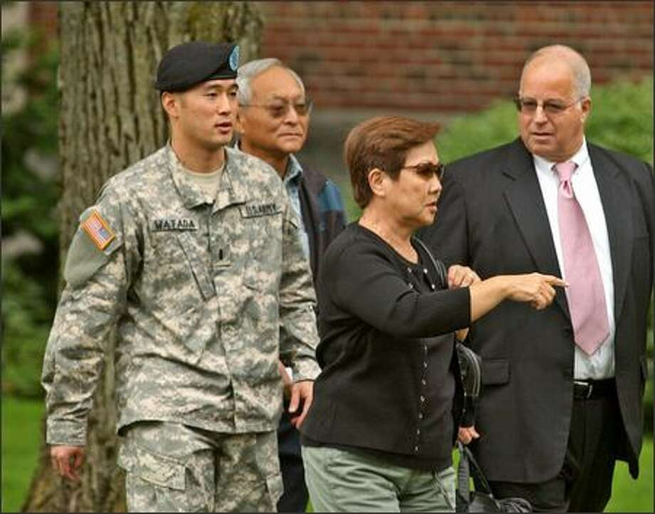 Lt. Ehren Watada, left, walks with his father, Bob Watada; his stepmother, Rosa Sakanishi; and attorney Eric Seitz during a lunch break in an Army hearing on Watada's refusal to deploy to Iraq. Photo: / Associated Press
