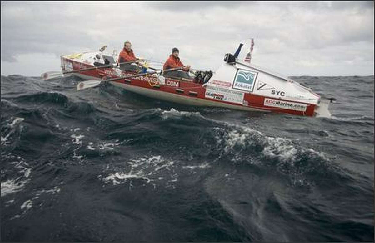 Brad Vickers, left, and Dylan LaValley, part of a four-man team from Seattle, row in their boat following their win in a trans-Atlantic race.