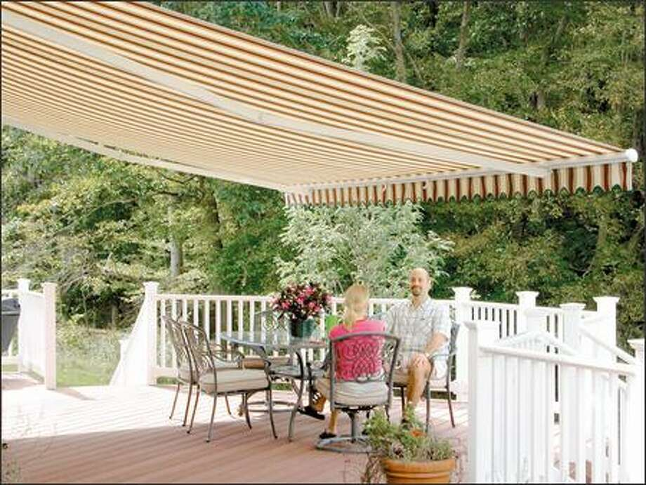 Retractable awnings let you decide when you want cover. They can be customized to fit your deck, such as this long but narrow one. Photo: CRAFT-BILT