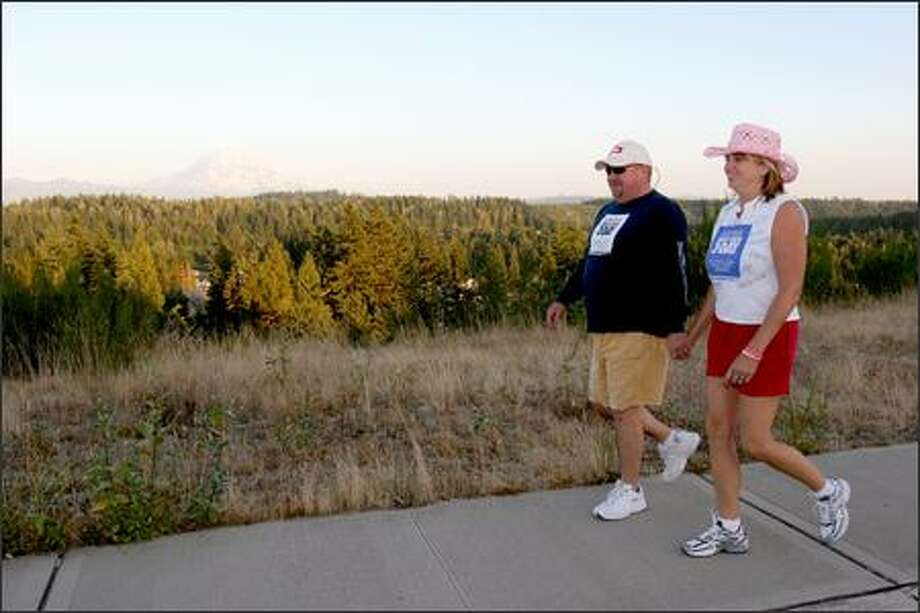 Karen and Mark Libby go for a walk near their home in Bonney Lake as part of their conditioning for the 3-day, 60-mile breast cancer walk they will start today. Karen is a breast cancer survivor. Photo: Meryl Schenker/Seattle Post-Intelligencer
