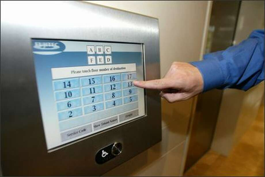 """A keypad in the lobby of the Metropolitan Park West building directs """"smart elevators."""" Photo: Jim Bryant/Seattle Post-Intelligencer"""