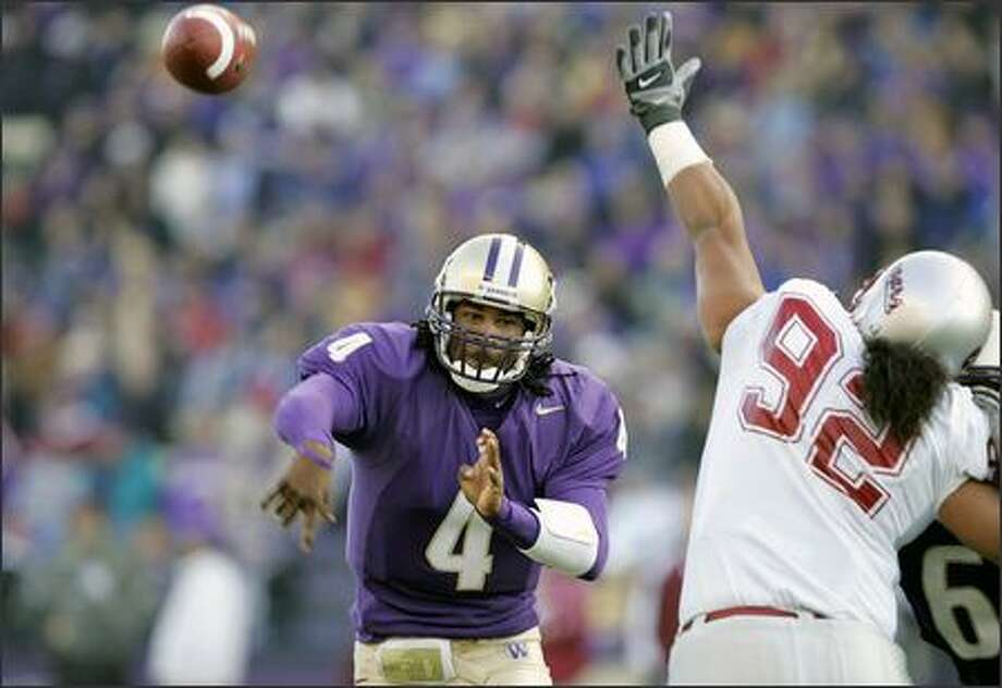 Huskies quarterback Isaiah Stanback, throwing a pass in last year's Apple Cup loss, says being a vocal leader doesn't come naturally to him but he's adjusted to the role. Photo: / Associated Press