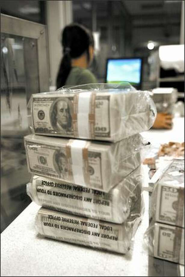 Hundred-dollar bills packaged into bundles called bricks wait to be counted at the Federal Reserve Bank's Seattle branch on Second Avenue. A single brick contains 16,000 bills of one of six denominations. Photo: Grant M. Haller/Seattle Post-Intelligencer