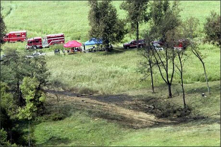 Fire and impact marks are visible on the ground in a field west of Blue Grass Airport in Lexington, Ky., where Comair Flight 5191 crashed during takeoff on Sunday. Forty-nine people were killed. The first officer, who was flying the plane, survived. Photo: / Associated Press