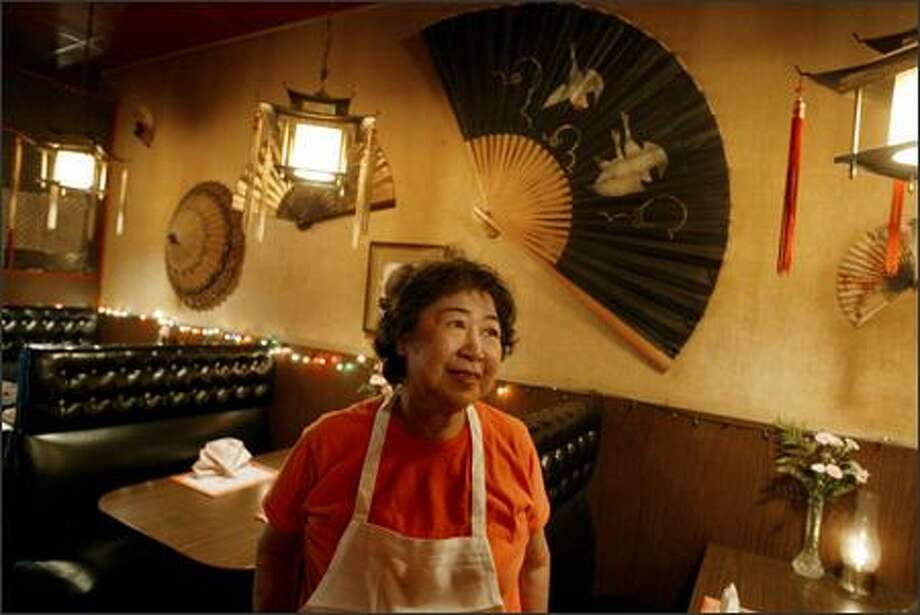 """Pearl Woo, owner of the Jade Pagoda, a landmark restaurant and bar in Capitol Hill that is shutting its doors after more than six decades, says some old regulars have been dropping by lately to say their farewells. """"I thought they were dead,"""" she joked. Photo: Meryl Schenker/Seattle Post-Intelligencer"""
