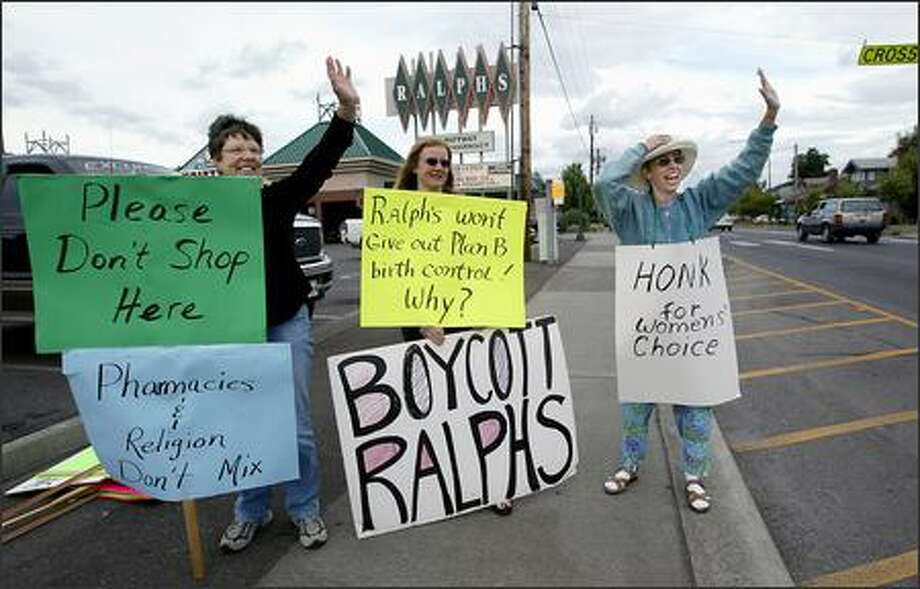 Jeanne Koenigs, left, Janet Blanding, middle, and Linda Malanchuk-Finnan rally Tuesday in front of Ralph's Thriftway in Olympia, where a number of women were unable to attain Plan B. Photo: Scott Eklund/Seattle Post-Intelligencer