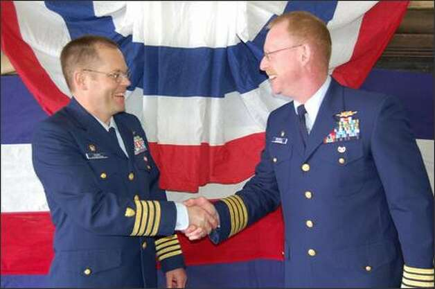 Capt. Douglas Russell, right, took over command of the Healy from Capt. Daniel Oliver in June. Now Oliver is coming back. Photo: / U.S. Coast Guard