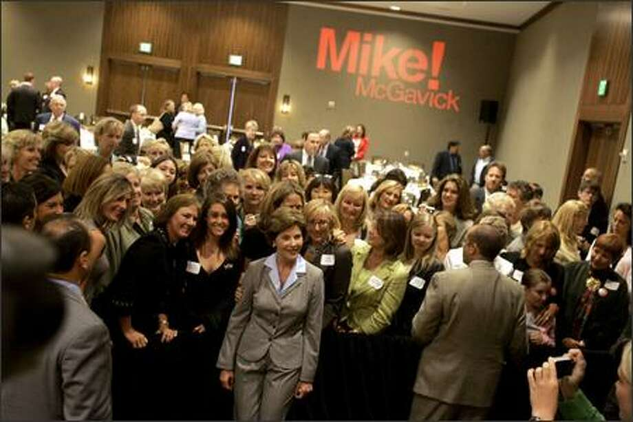 First lady Laura Bush poses with supporters of Republican Senate candidate Mike McGavick at a fundraiser for McGavick on Wednesday. Photo: Mike Kane/P-I