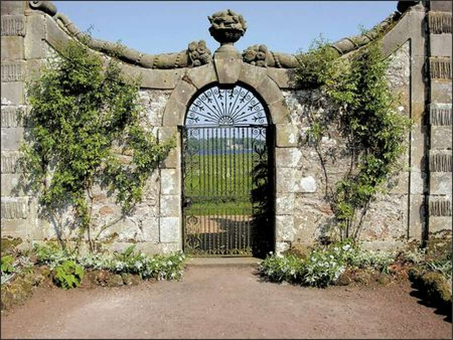 A gate in the walled garden at Kinross House frames a view of the island where Mary Queen of Scots was held prisoner. Photo: Marty Wingate/for The Seattle Post-Intelligencer