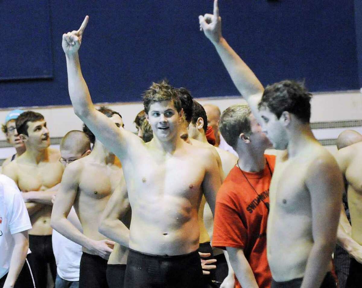 Andrew Dillinger, center, of Greenwich High School holds up the number one sign with his teammates as GHS won the State Open Swimming Championships at Yale University, New Haven, Conn., Saturday afternoon, March 19, 2011.