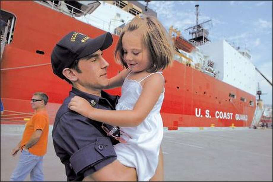 Petty Officer 2nd Class Danny Harris holds daughter Rhiana after the Coast Guard cutter Healy and its crew returned Sunday to Seattle from a mission in the Arctic Ocean. Photo: Jim Bryant/Seattle Post-Intelligencer