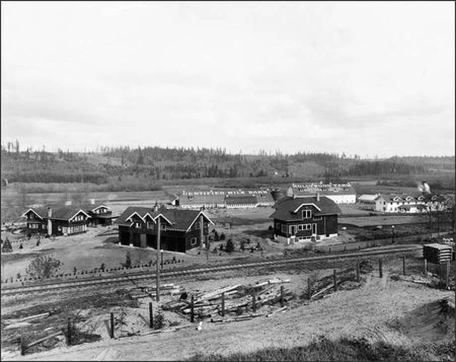 Taken circa 1914, this shows, from left, the manor house -- now used for special functions -- and the carriage and caretaker houses, which are now offices. Photo: Courtesy Of Chateau Ste. Michelle