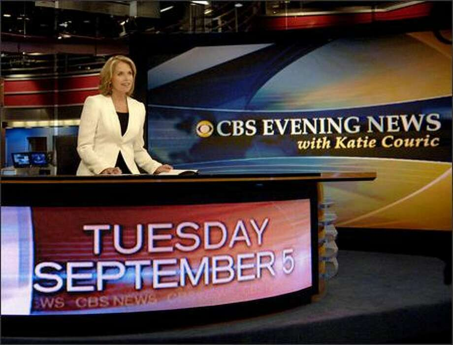 In this photo released by CBS, Katie Couric, anchor and managing editor of the CBS Evening News with Katie Couric, makes her debut broadcast on the CBS Television Network from the CBS Broadcast Center in New York, on Tuesday. Photo: / Associated Press