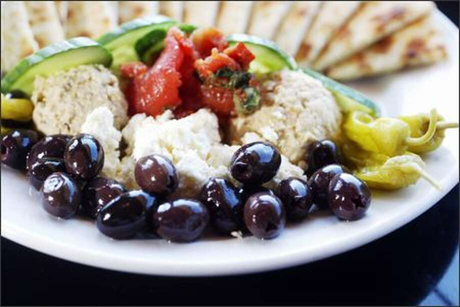 The Mediterranean Platter has garlic hummus, eggplant babaganoush, Greek feta cheese, kalamata olives, roasted tomatoes, cucumbers and grilled pita bread for $9.50. Photo: Karen Ducey/Seattle Post-Intelligencer