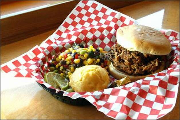 The pulled-pork sandwich comes with muffin, succotash and a dollop of Southern hospitality. Photo: Karen Ducey/Seattle Post-Intelligencer