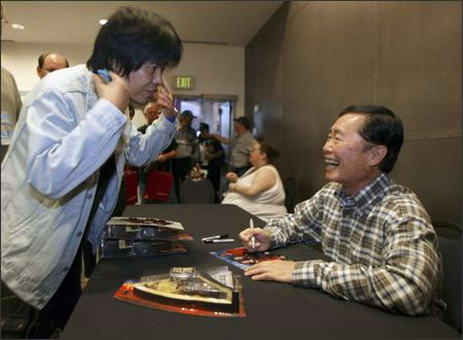 "George Takei, who played Mr. Sulu on the original ""Star Trek"" series, laughs it up with fan Masaya Hawagushi of Hamamatsu, Japan, at the Science Fiction Museum. Photo: Jim Bryant/Seattle Post-Intelligencer"