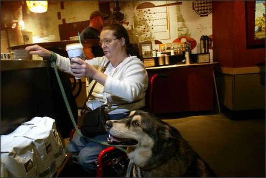 Dawn Lucas has won $2,500 in a civil rights case against the Georgian Motel, which refused to take her service dog, Otter. Photo: Karen Ducey/Seattle Post-Intelligencer