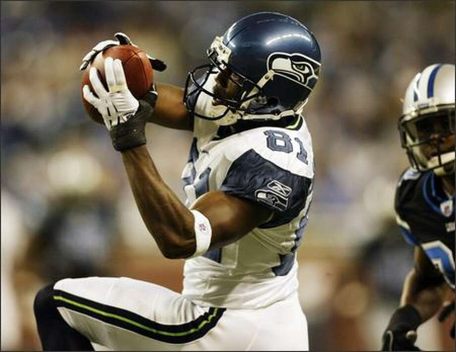 Seahawks wide receiver and O'Dea High graduate Nate Burleson had one catch for 36 yards Sunday against the Lions. Photo: Mike Urban/Seattle Post-Intelligencer