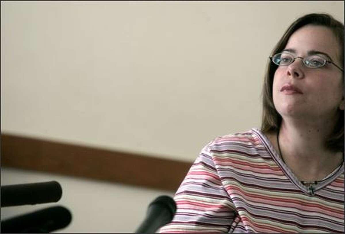 Jewish Federation shooting victim Carol Goldman talks to reporters Tuesday at Harborview.