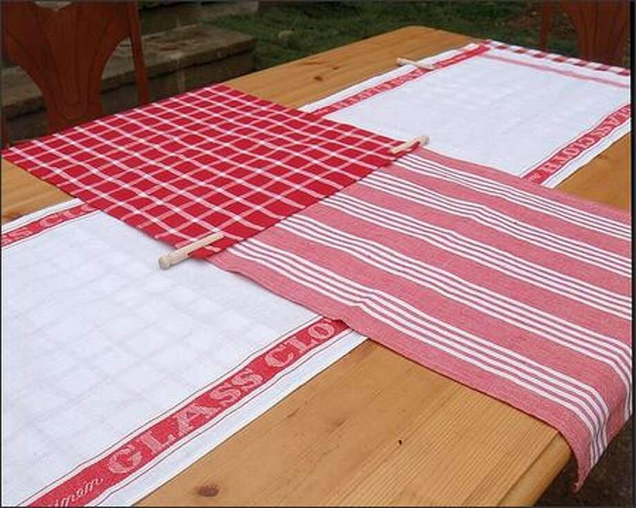 Vintage tea towels are too fragile for drying dishes, but they make a perfect runner for a casual table. Photo: /