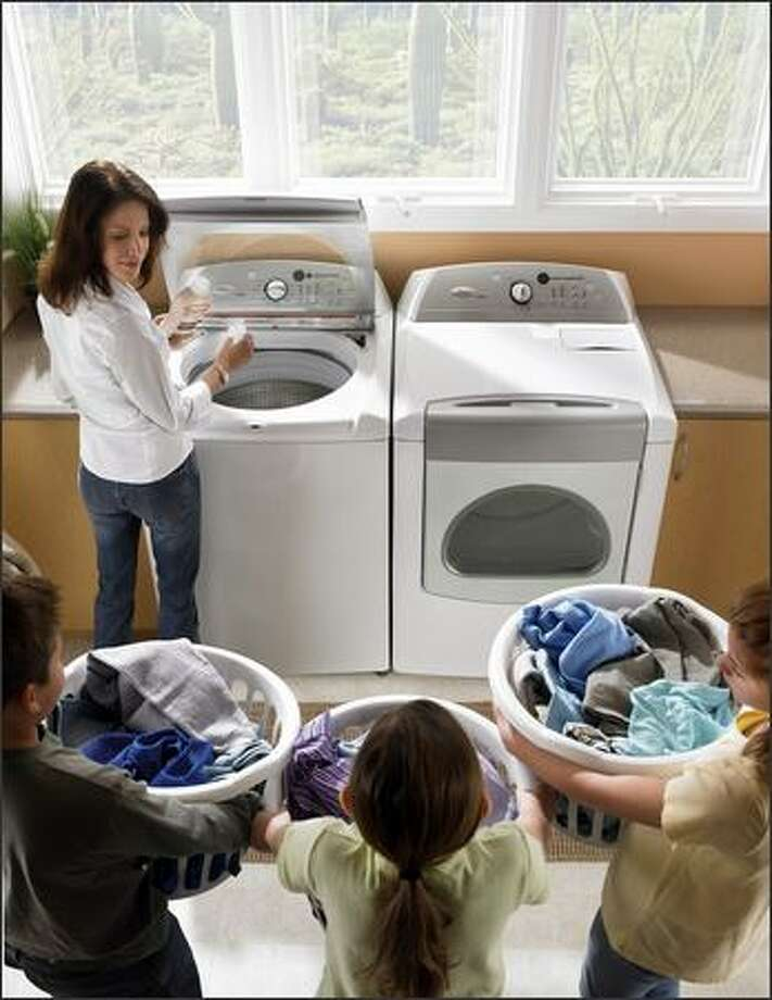 This Whirlpool Cabrio model washes 4.5 cubic feet of clothes using about half as much water as a standard top-loading washer. Photo: WHIRLPOOL